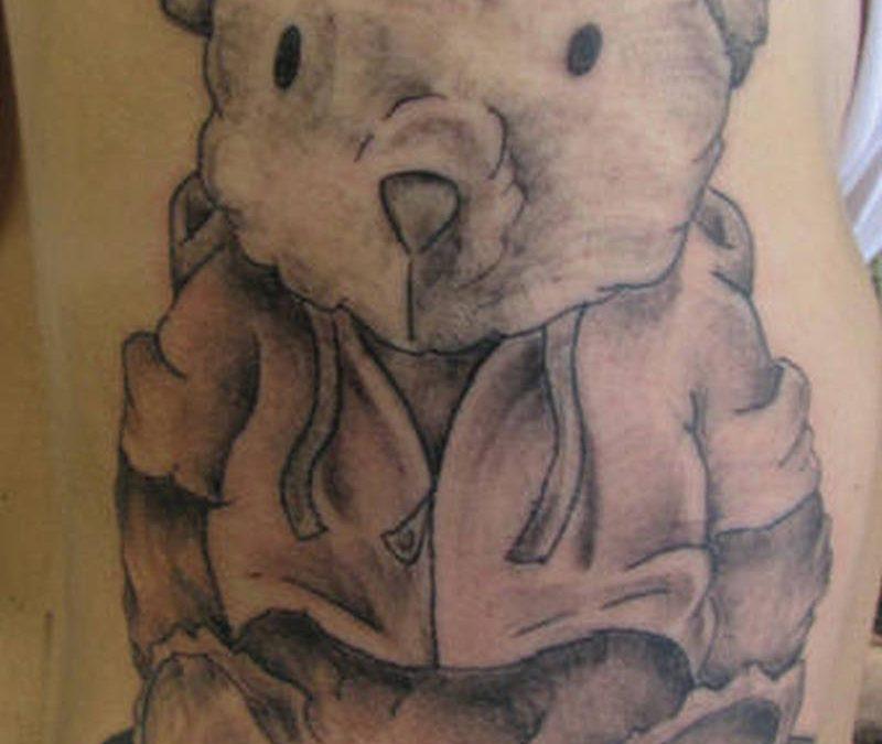 Big bear tattoo on arm