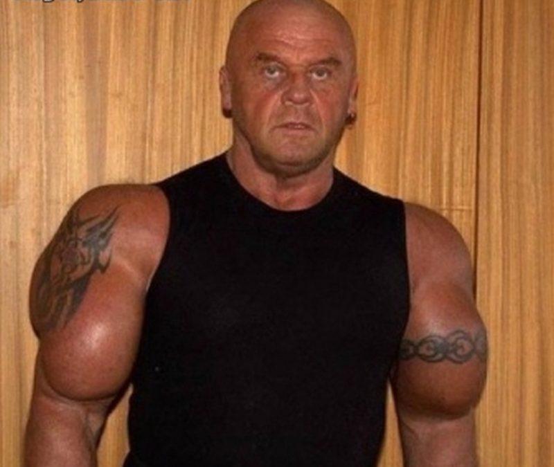 Big biceps tattoo on muscular man