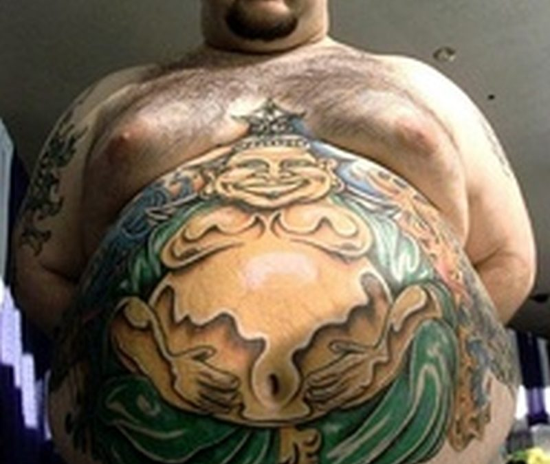 Big buddha belly button tattoo