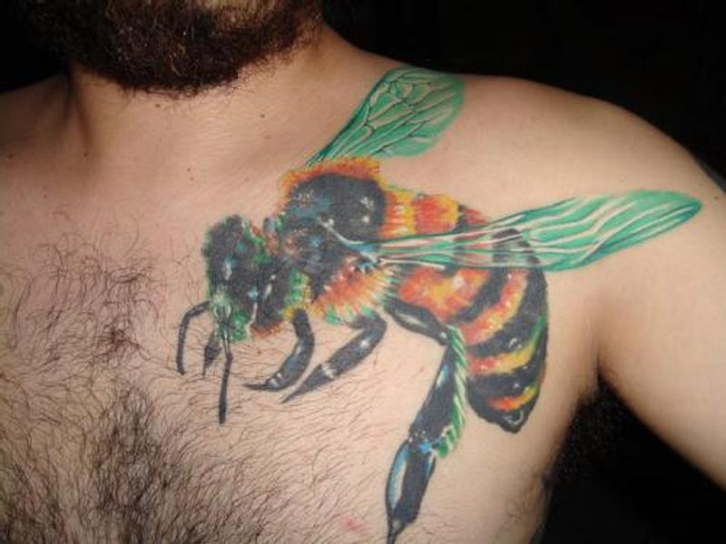 Big bumblebee tattoo on chest for men