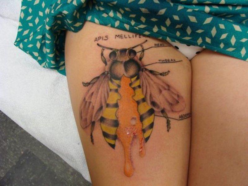 Big bumblebee tattoo on thigh