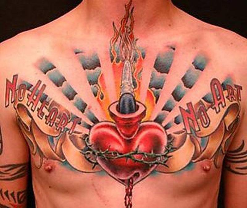 Big claddagh tattoo on chest