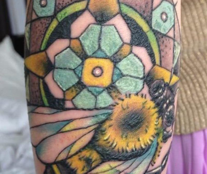 Big colorful bee tattoo on arm
