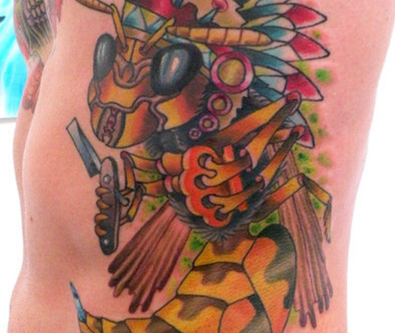 Big colorful bee tattoo on rib side