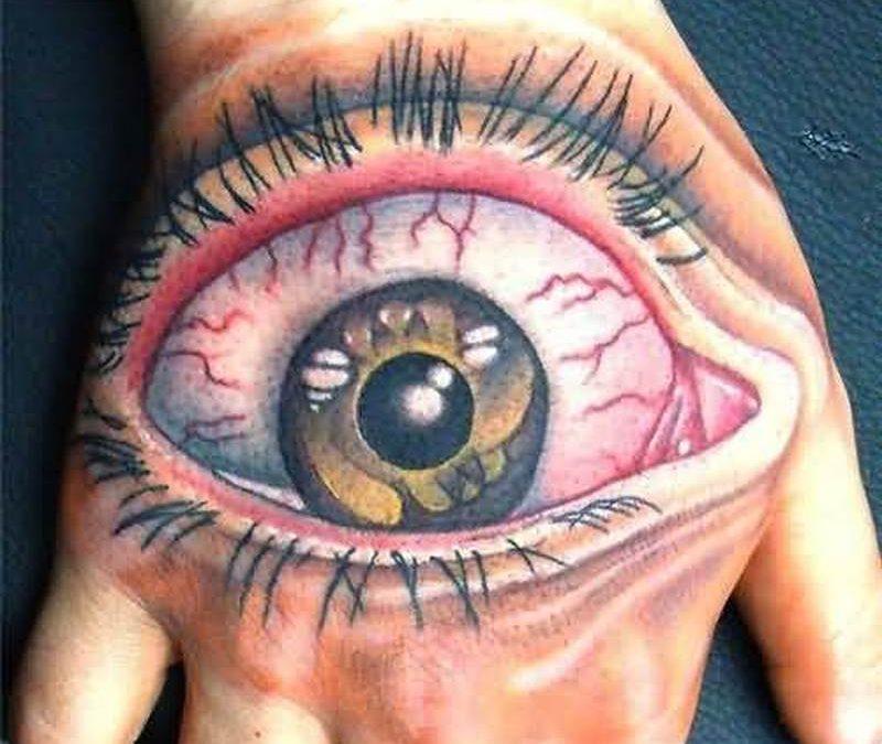Big eye hand tattoo design