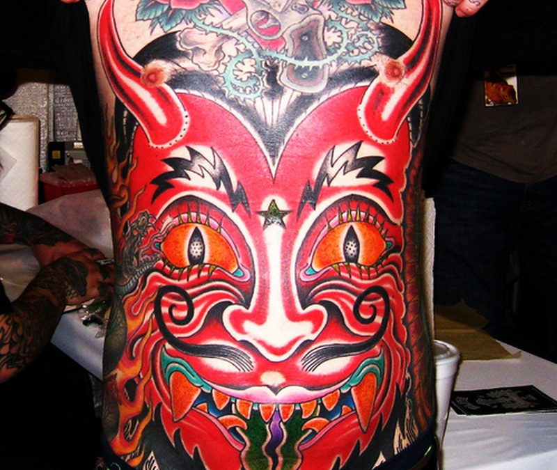Big red ink tattoo for belly