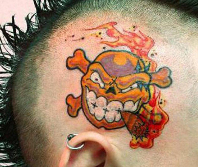 Big teeth cartoon tattoo on head