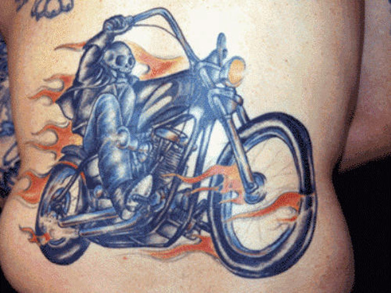 Biker in flames tattoo