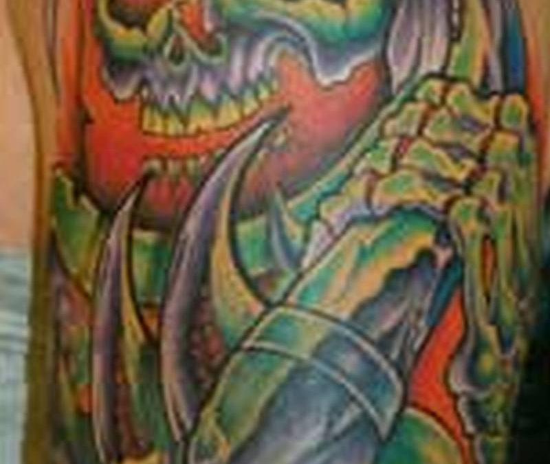Bio mechanical grim reaper tattoo on shoulder