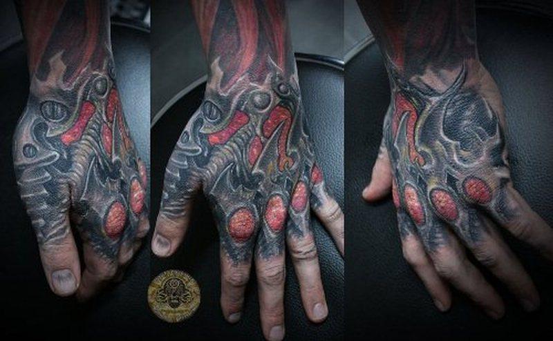 Biomech horror hand tattoo design