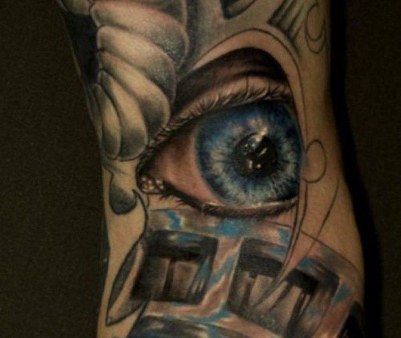 Biomechanical eye ball tattoo design