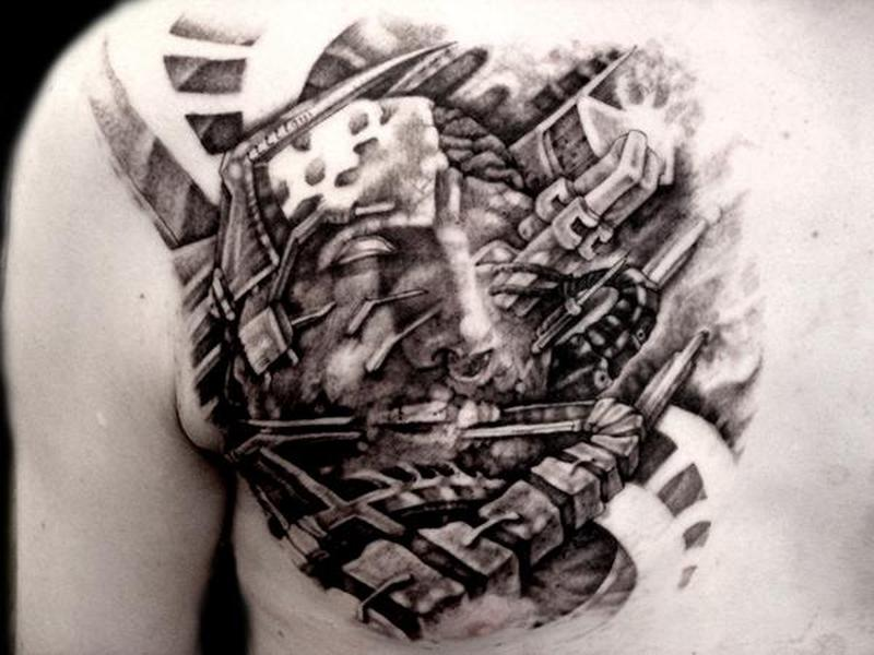 Biomechanical face tattoo on chest