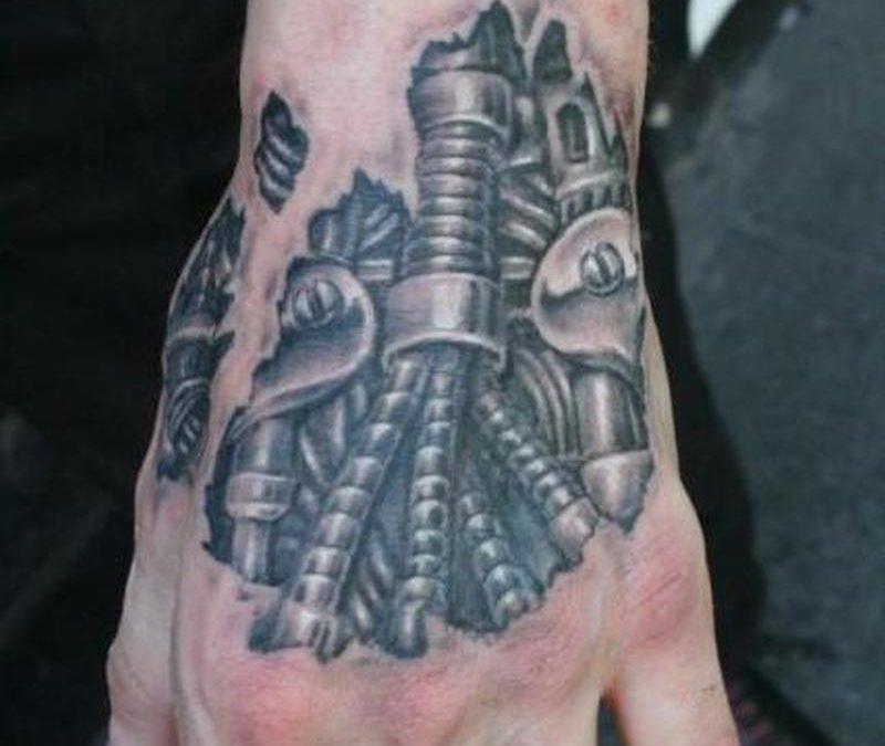 Biomechanical hand tattoo