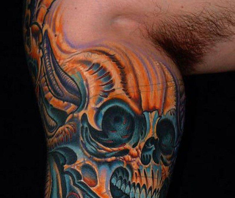 Biomechanical leg skull tattoo
