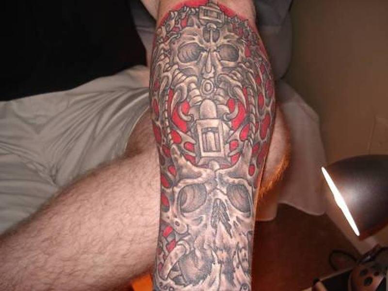 Biomechanical skull tattoo on forearm