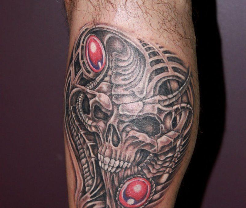 Biomechanical skull tattoo on leg