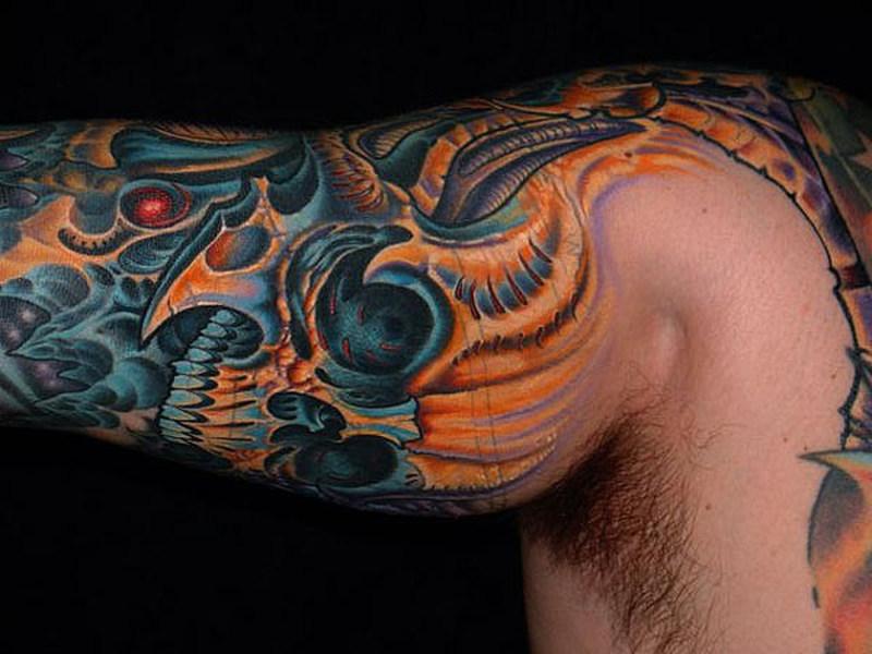 Biomechanical skull tattoo on muscles