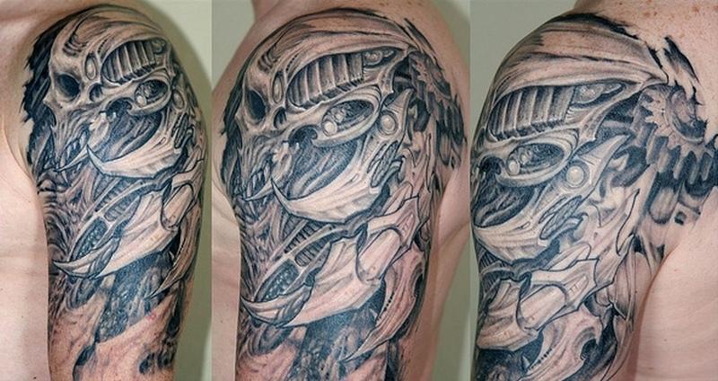 Biomechanical skull tattoo on shoulder