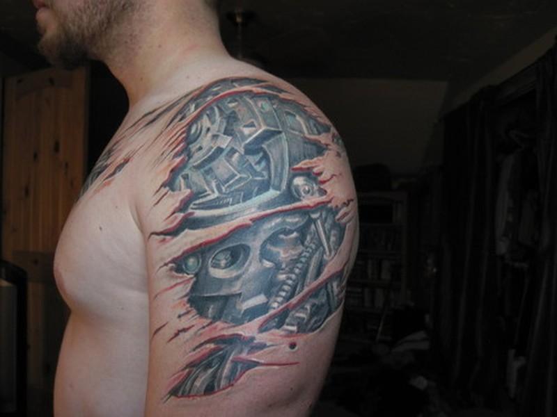 Biomechanical tattoo on shoulder arm