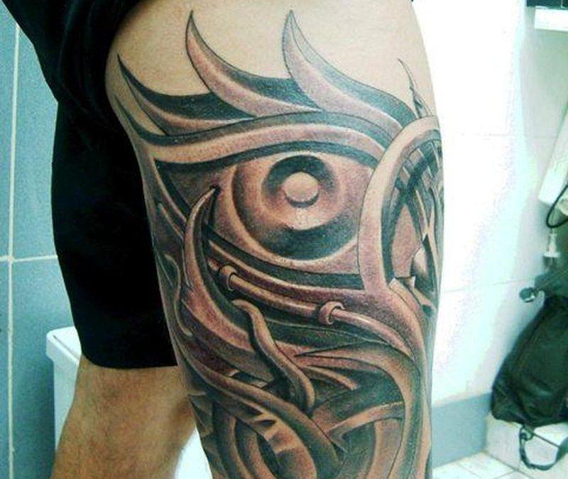 Biomechanical thigh tattoo