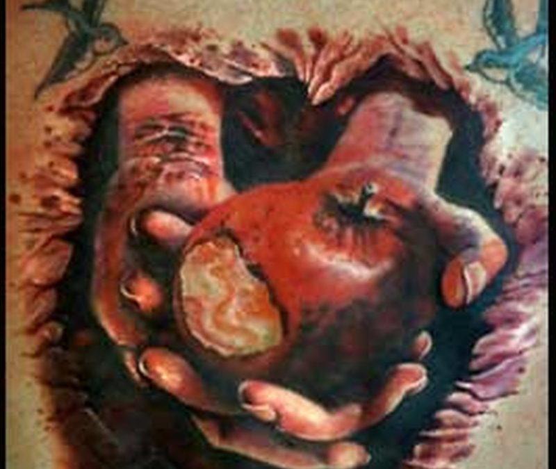 Bitten apple in hands tattoo design