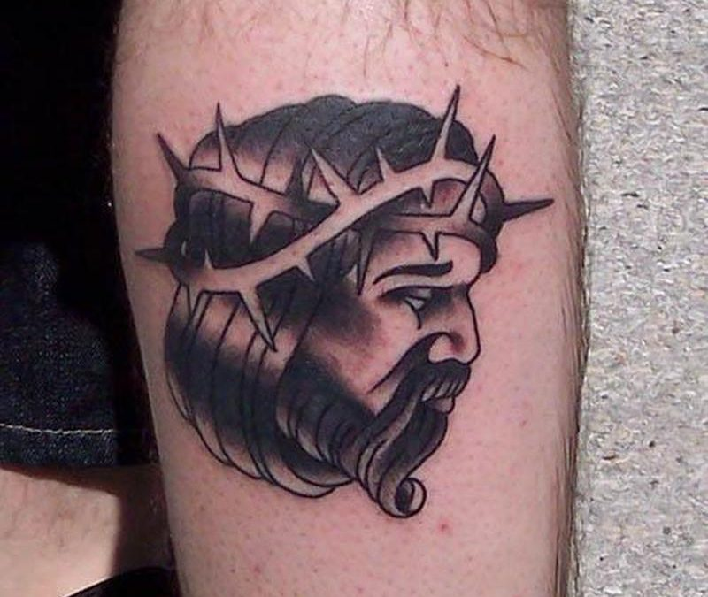 Black and grey traditional jesus tattoo design