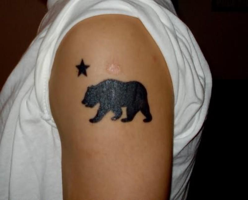 Black bear tattoo with star