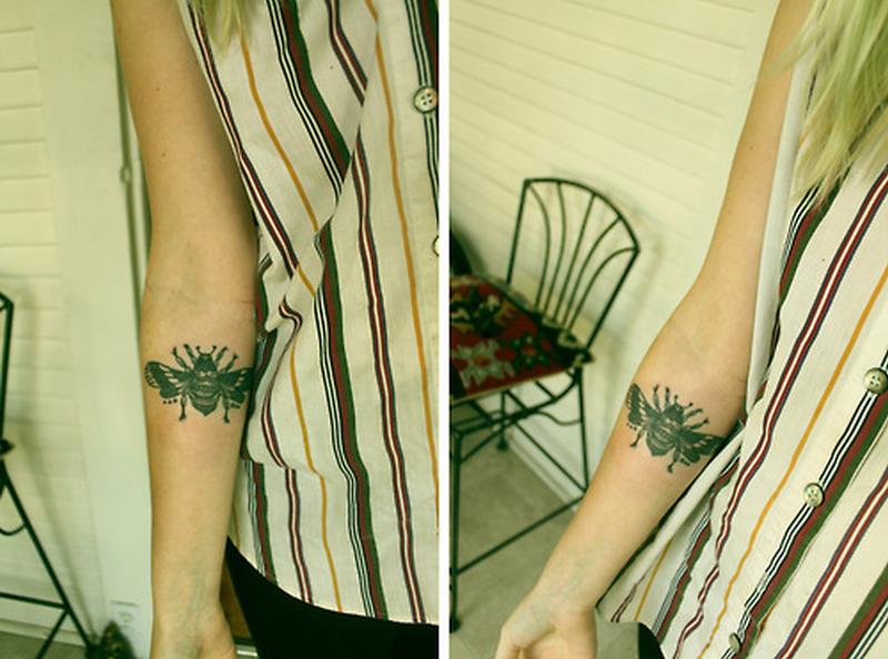 Black bumblebee tattoo on forearm