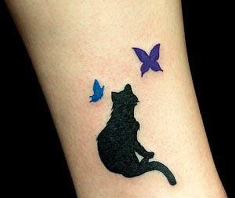 Black cat tattoo with butterflies