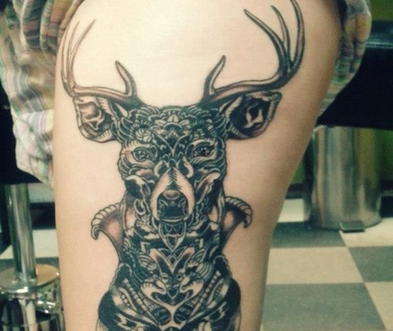 Black deer tattoo on thigh