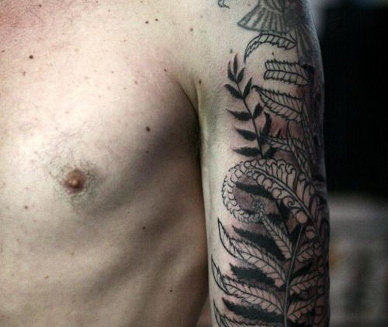 Black fern tattoo on half sleeve by Alice Carrier