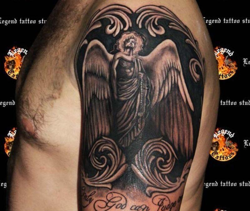Black ink angel tattoo design on shoulder