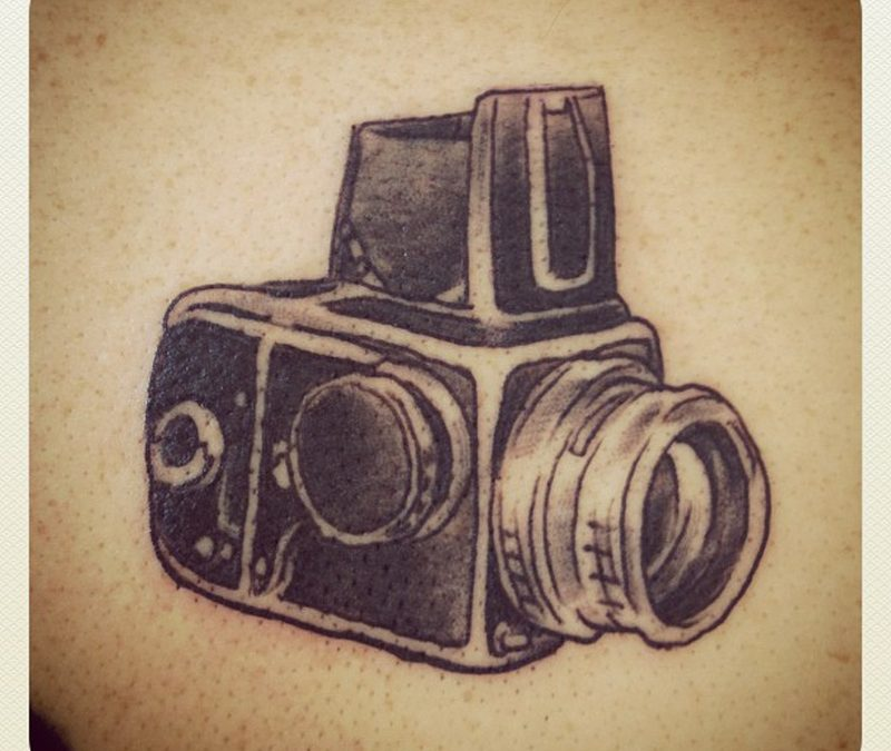Black ink camera tattoo image 2