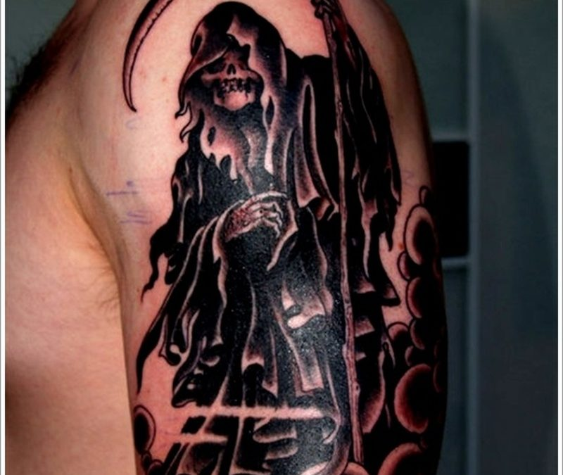 Black ink grim reaper tattoo on biceps