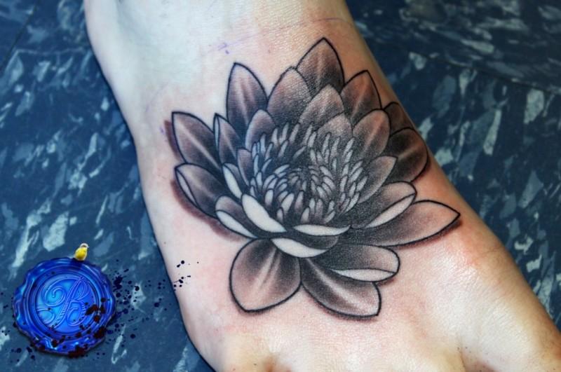 Black lotus flower tattoo on foot