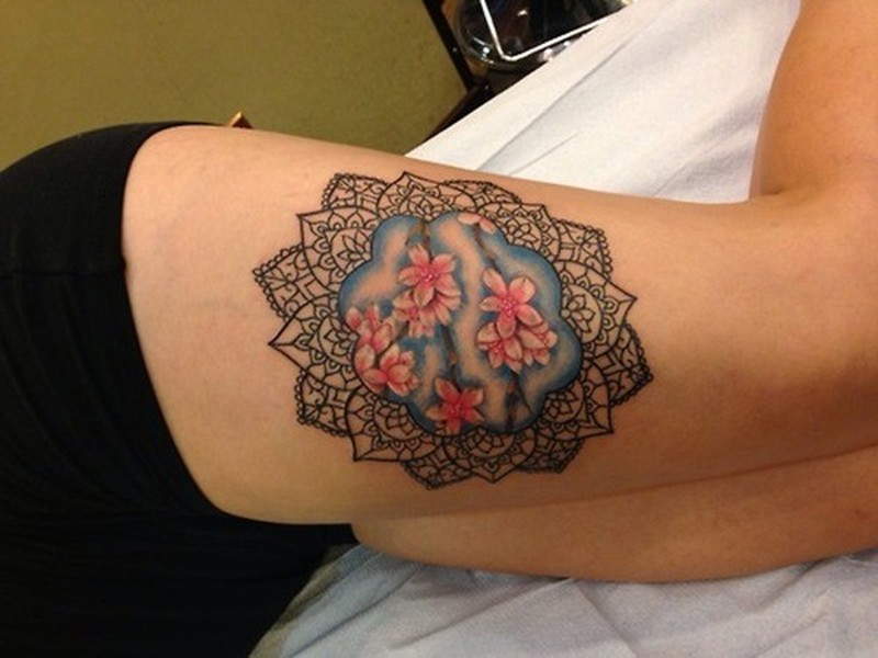 Black mandala with pink flowers tattoo on thigh for women