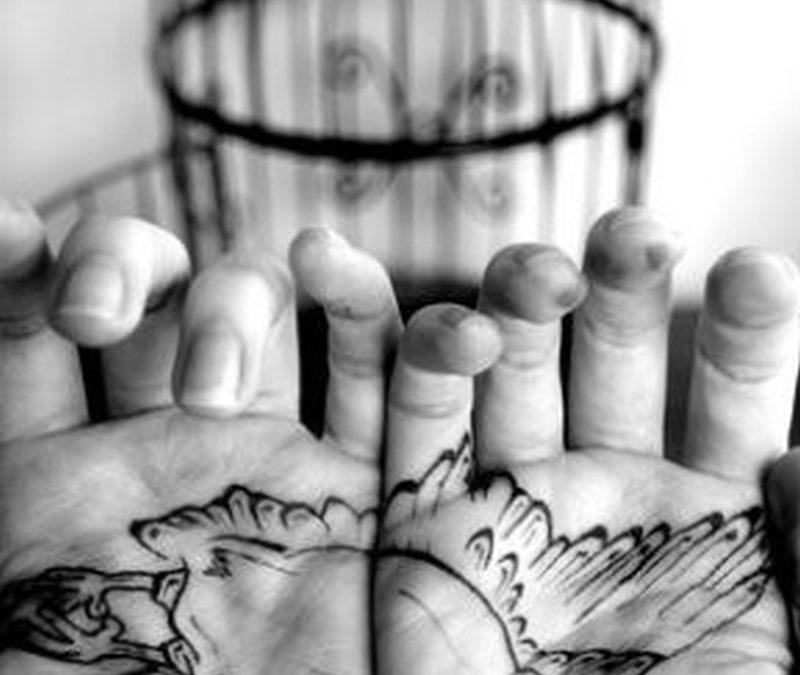 Black white bird tattoo on palm