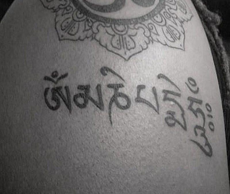 Black white religious buddhist tattoo
