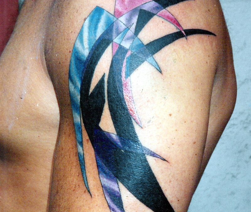 Blue pink purple abstract upper arm tattoo