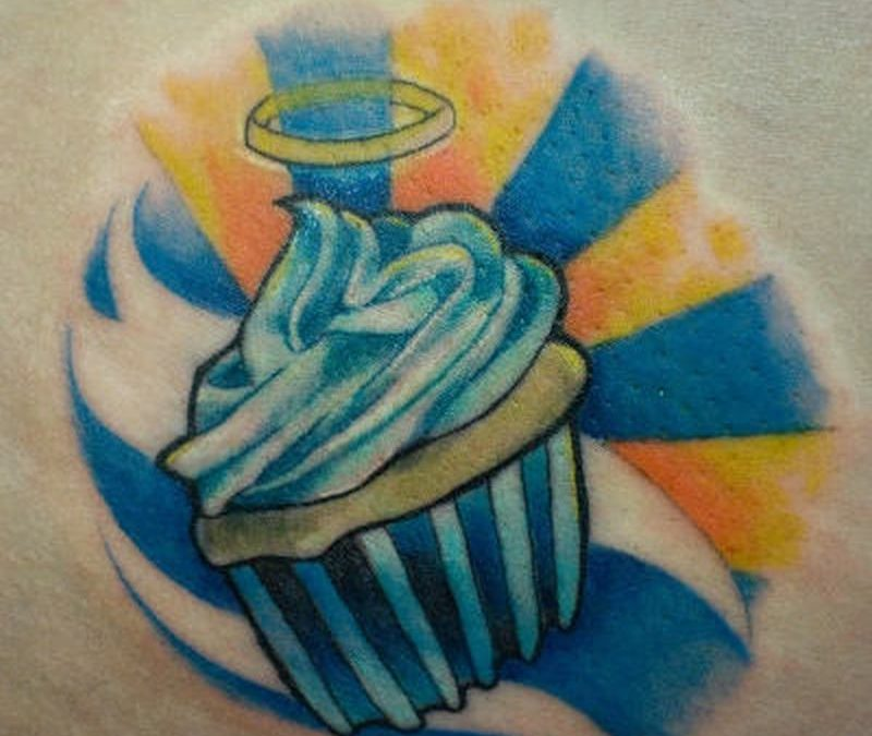 Blue yellow cup cake tattoo