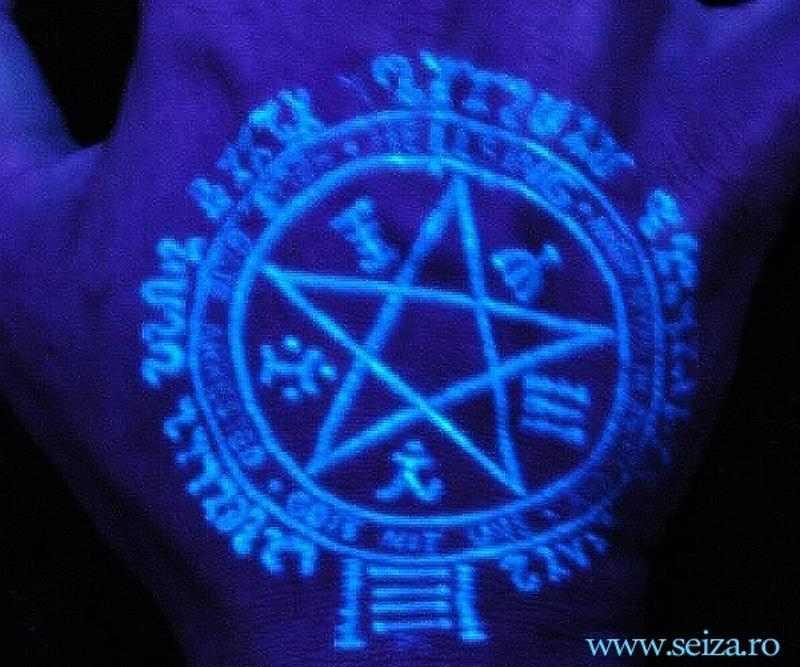 Brilliant blacklight tattoo design on hand