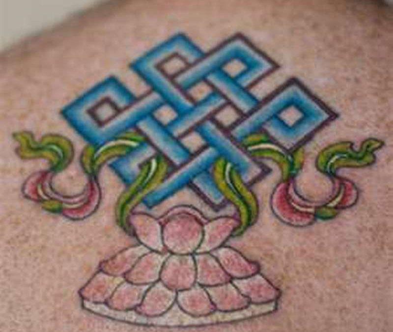 Buddhist symbol tattoo