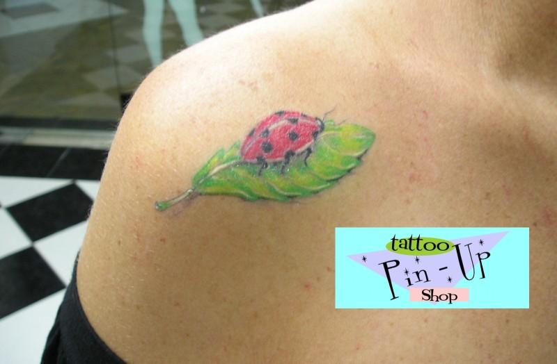 Bug on leaf tattoo on shoulder