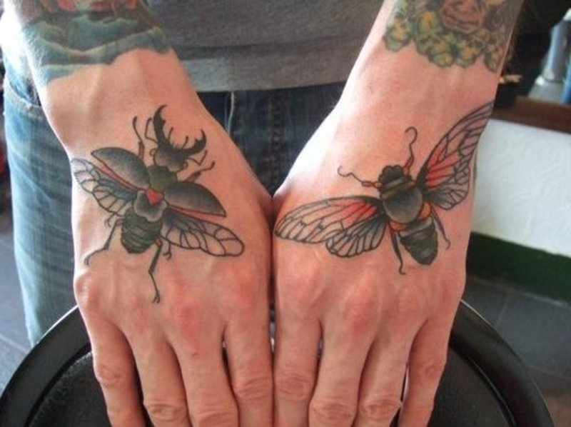 Bug tattoo designs on hand
