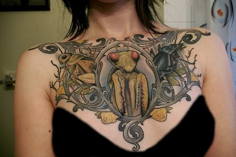 Bug tattoo on chest