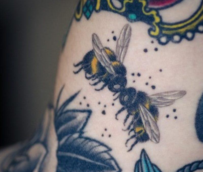 Bumblebee kissing tattoo