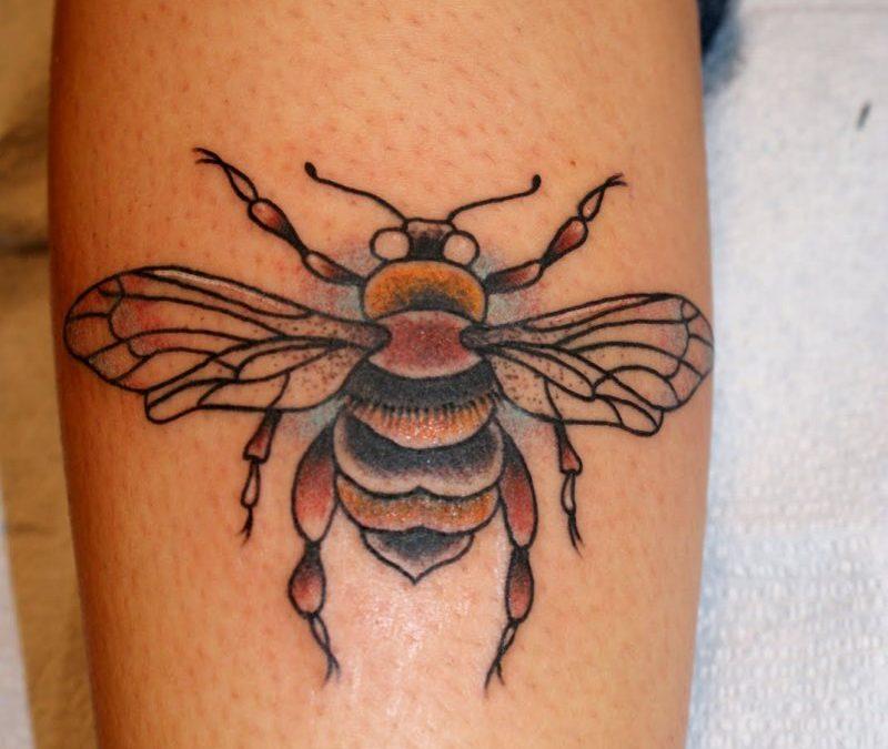 Bumblebee tattoo on calf
