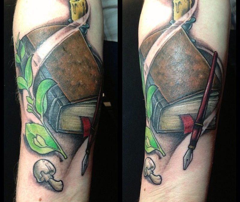 Burning candle with book tattoo image