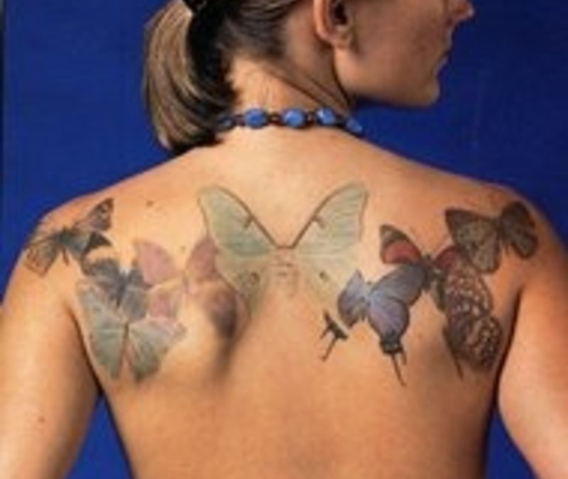Butterflies tattoo on upper back for girls