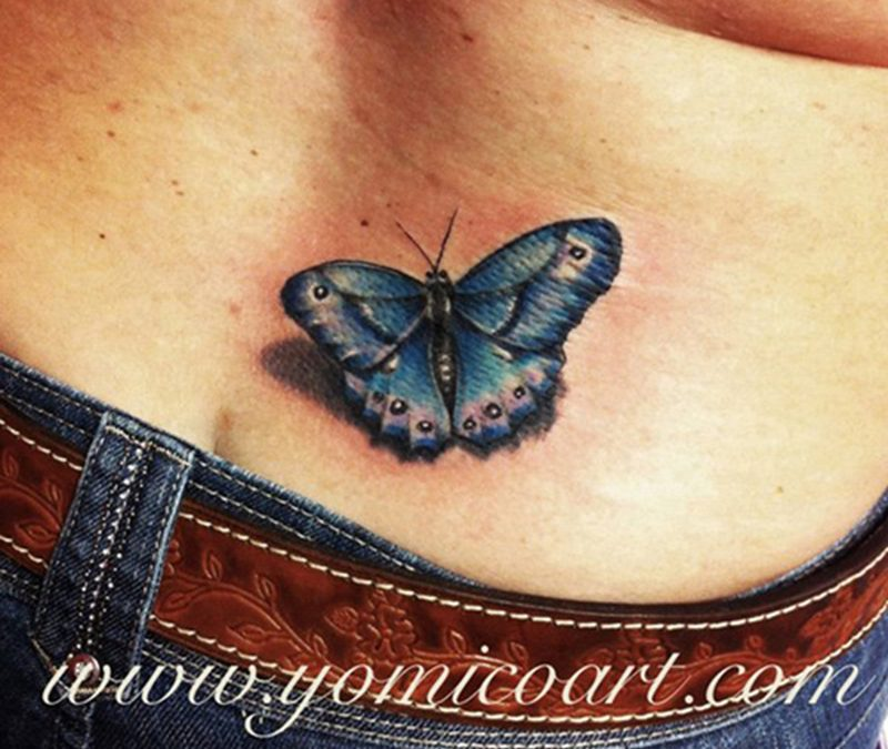 Butterfly tattoo on lower back 3